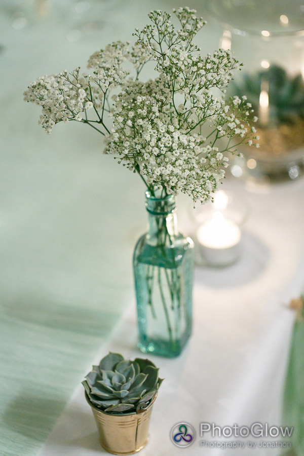 babys breath in vintage glass bottles