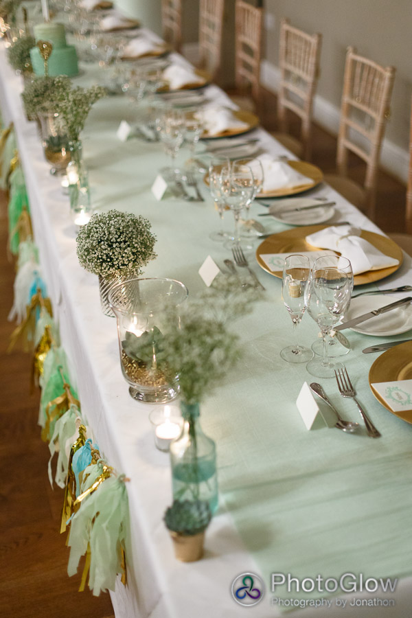 mint gold top table with tassel garland